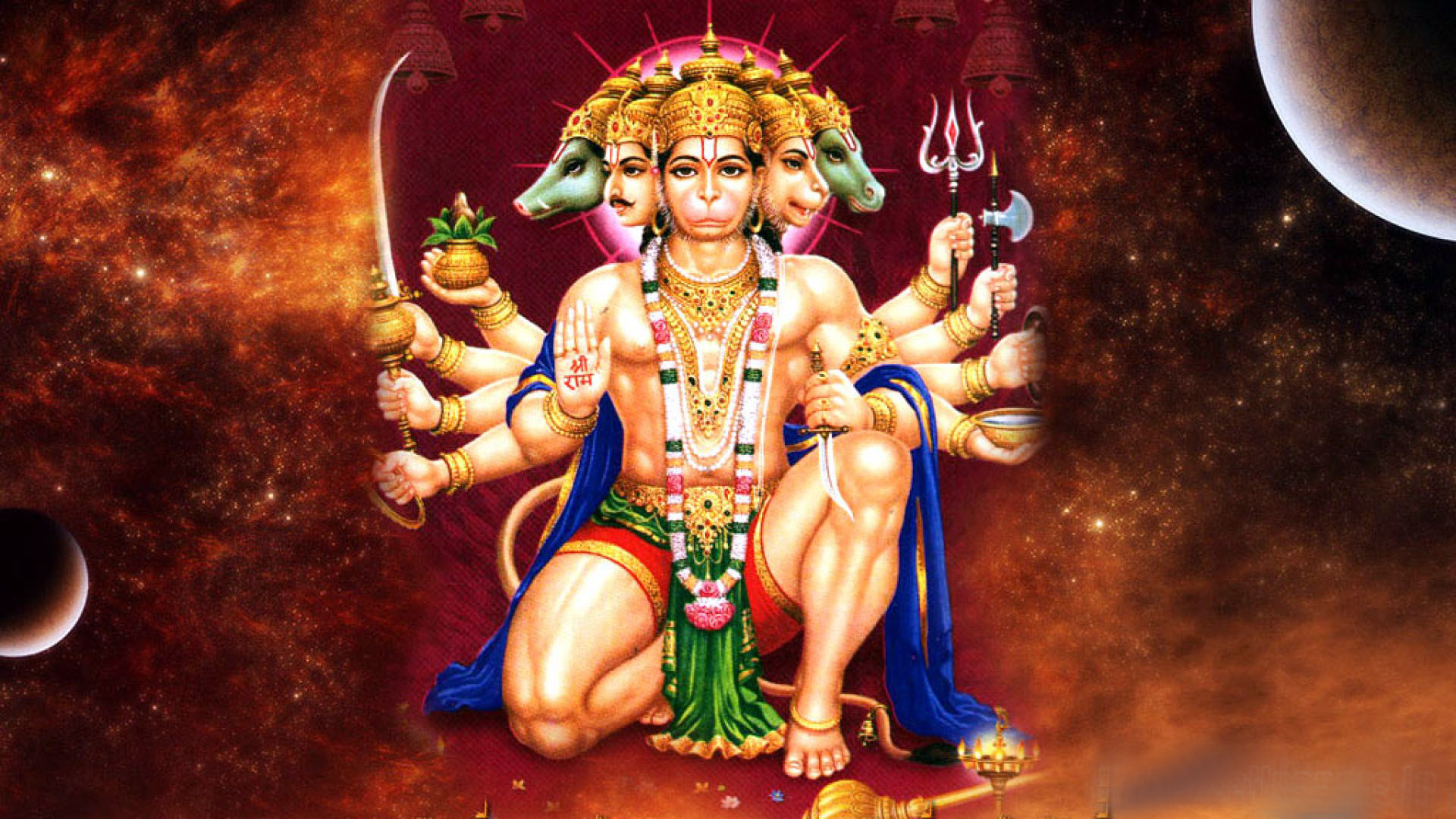 Lord Hanuman in his original face with there weapon
